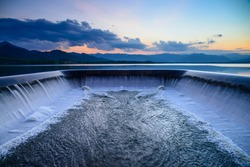 Water overflow into a spillway