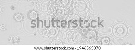 Water panoramic banner background. White water texture, blue mint water surface with rings and ripple. Spa concept background. Flat lay, top view, copy space, square composition with copy-space.