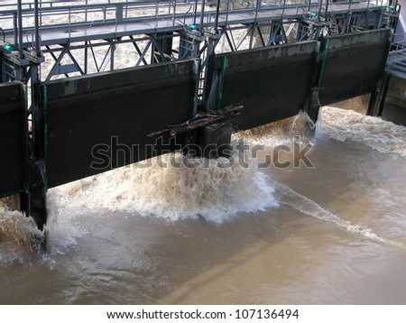 Water passing through dam wall on the river Lambro, Italy - stock photo