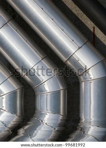 Water pipes from pumping station with reflection