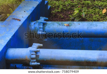 Water pipes of sewage treatment plant in tropical rainforest in Costa Rica - Tacares, Alajuela province, Costa Rica