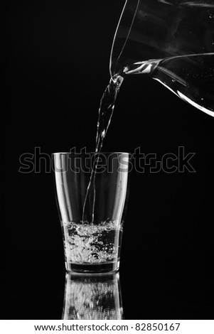 Water pitcher pouring a glass of fresh water