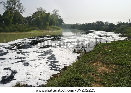 Water pollution in river because industrial not treat water before drain