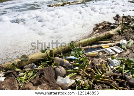 Water pollution - old garbage and pollution in river