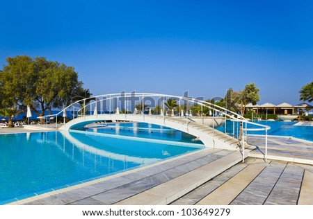 Water pool and bridge - vacation background