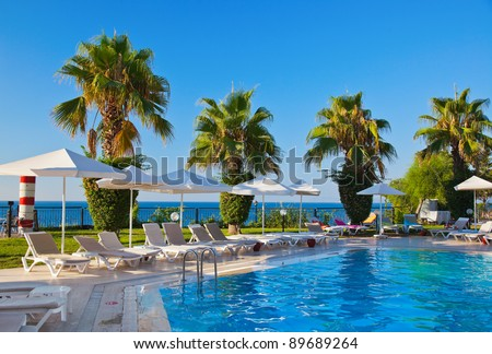 Water pool and chairs - vacation background