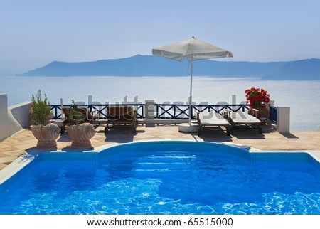 Water pool at Santorini, Greece - vacation background
