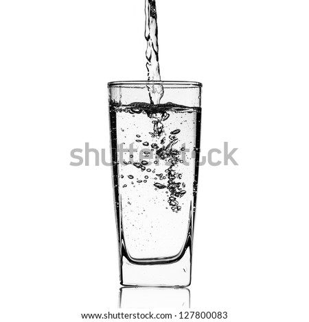 Water pour into glass on white