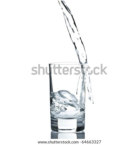 Water poured in a glass against white background - stock photo