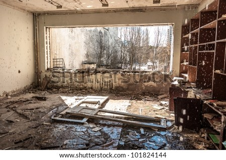 Water pouring down on wall in abandoned room in pripyat
