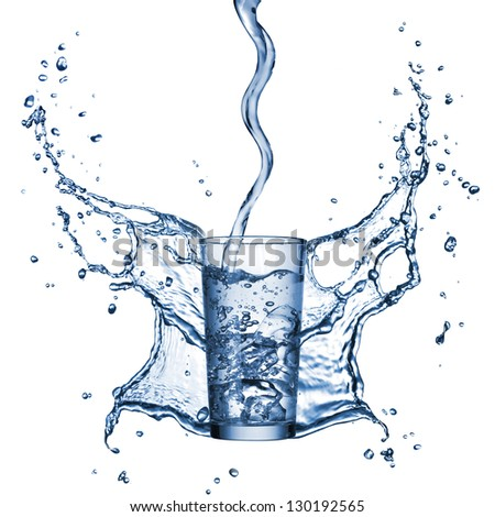 water pouring into the glass with splash isolated on white