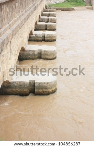 Water pouring through the sluice gates at dam