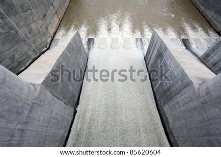 Water pouring through the water gates at dam