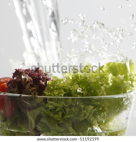 water pouring to the fresh salad