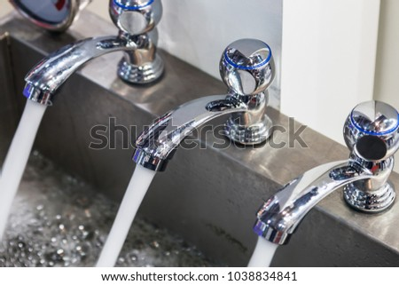 water pours out of the faucets. Plumbing equipment, fittings, pipes, faucet, etc. #1038834841