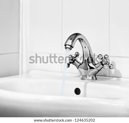 Water Pours Out Of The Open Valve