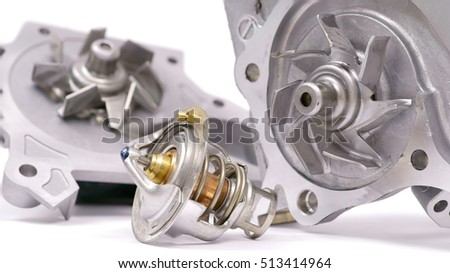 water pump and thermostat, two elements of the engine cooling system #513414964