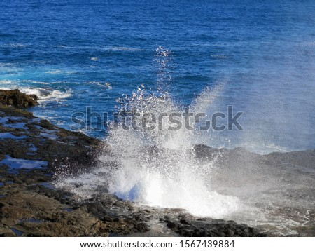 Water pushed through a blow hole on Kauai, Hawaii. #1567439884