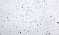 Water​ rain​ drops​ on​ glass​ background.​ Rain​ drops​ on​ a​ Windows.