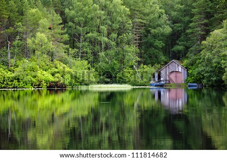 Water reflection of fisherman home in the middle of national park. Green, colorful surrounding with a clean lake.