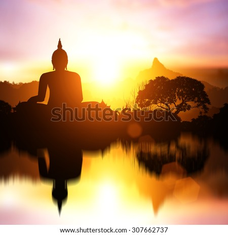 Water Reflection Silhouette of Buddha on  sunset with mountain behind.end of Buddhist Lent