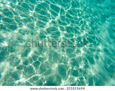 Water reflection/Transparent sea water. Clean water. Sand in sea.
