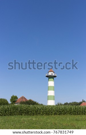 water reservoir tower under blue sky and green field in south germany rural countryside on a hot summer day in july #767831749