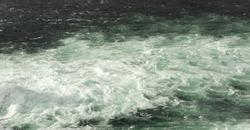 water running down in a clean river in Switzerland