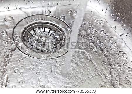 Water running down the drain