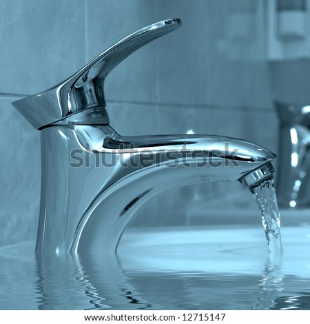 Water running from a modern water faucet