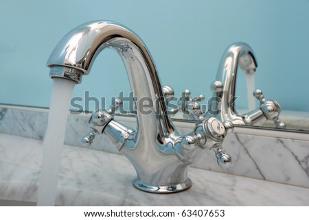 Water running from an open water faucet