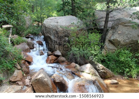 Water rushes in a mountain stream in the foothills of the Rocky Mountains near Colorado Springs, CO in Cheyenne Canon National Park. #1508166923
