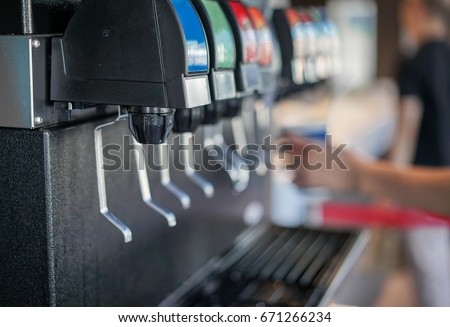 Water Soft drinks carbonated vending machine in restaurant shop soft focus #671266234