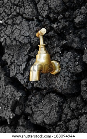 Water source concept, faucet on dry soil texture