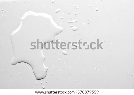 Water spilled on white table