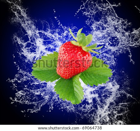 Water splash and fruits on blue background
