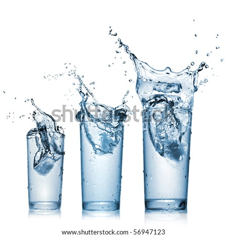 Stock Photo water splash in glasses isolated on white
