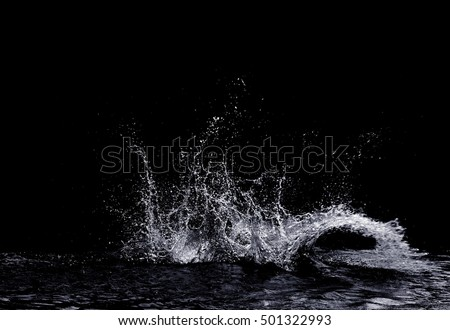 Photo of  water splash isolated on black background
