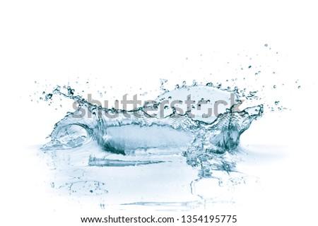 water splash isolated on white background #1354195775