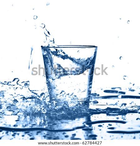 water splash on glass on white background