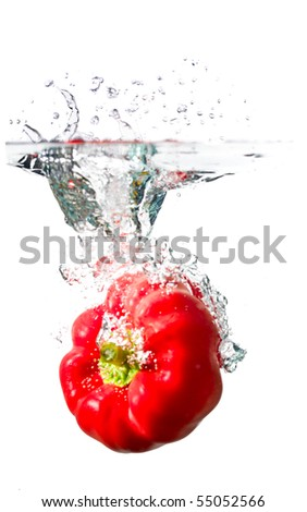 water splash on red pepper isolated on white