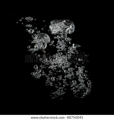 Water splash over black - stock photo