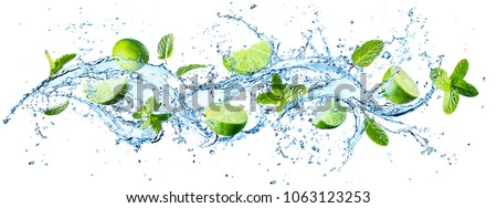 Water Splash With Mint Leaves And Slices Of Lime ストックフォト ©