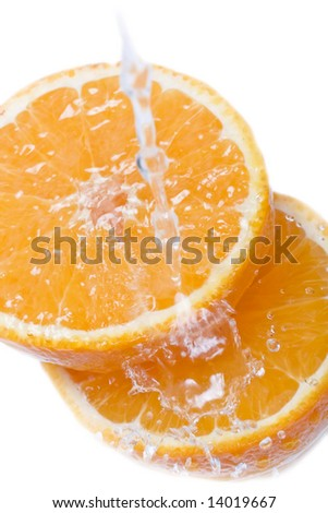 Water splashing on a fresh cut orange