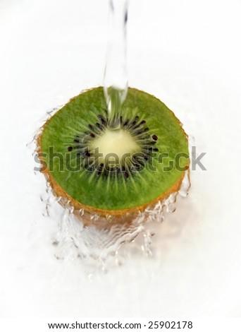 Water splashing on ripe kiwi fruit