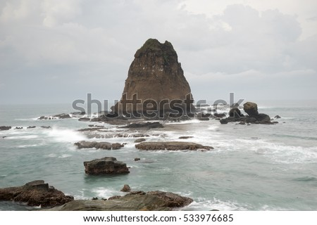 Water splashing waves on the sea at Papuma Beach, Jember, East Jawa, Indonesia #533976685