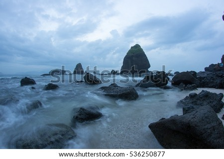 Water splashing waves on the sea at Papuma Beach, Jember, East Jawa, Indonesia #536250877