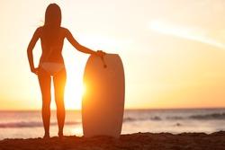 Water sport bodyboarding surfer woman on summer beach vacation holidays travel. Surfing girl holding bodyboard looking at ocean sea and sunshine. Beach bikini babe. Kaanapali beach, Maui, Hawaii.