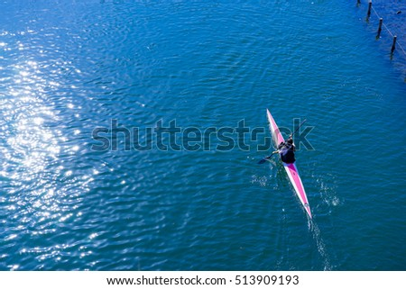 Water sports image, people rowing in canoe on river #513909193