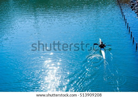 Water sports image, people rowing in canoe on river #513909208